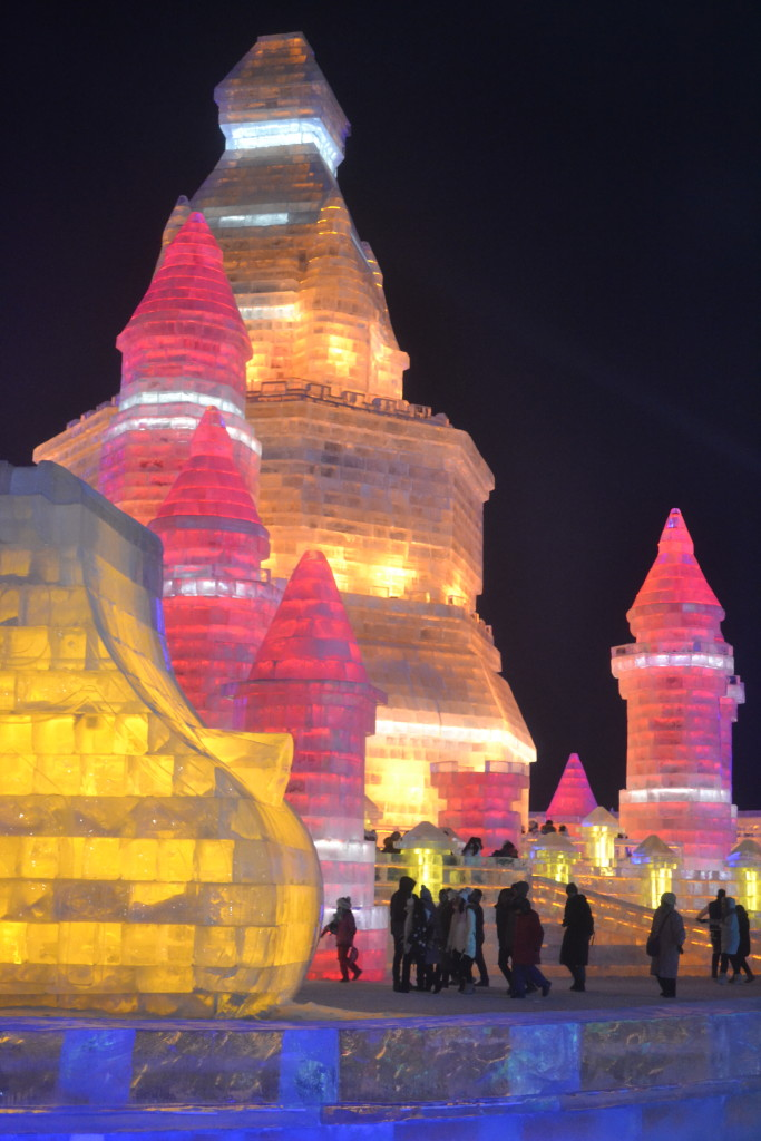 An illuminated ice palace at Ice & Snow World, Harbin, China